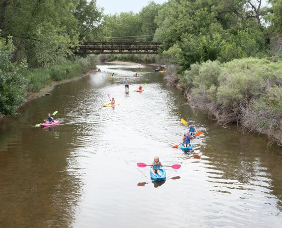 Kids kayak on the Cache la Poudre River