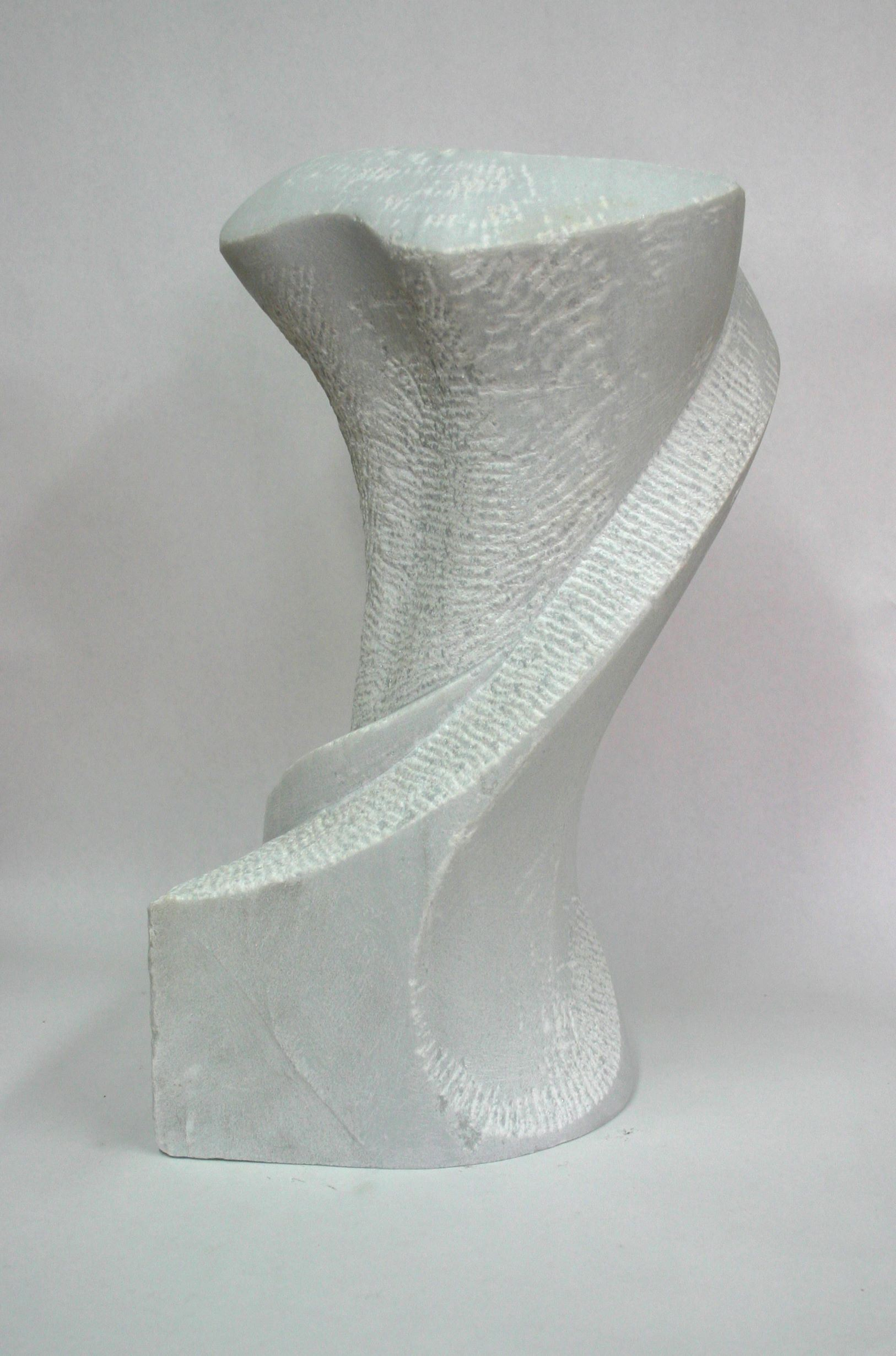 Image of a white, twisting sculpture made of stone.